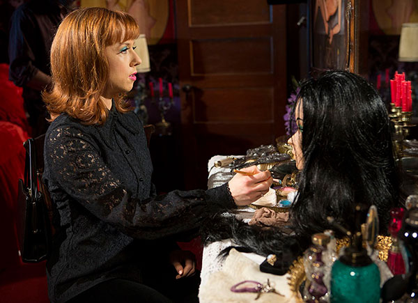 Trish (Laura Waddell) is bewitched by Elaine's makeup table, wig, and lingerie